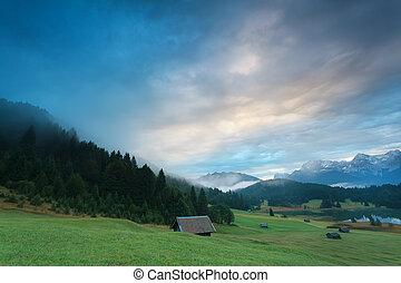 misty sunrise at alpine lake Geroldsee