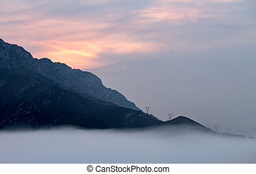 Misty Sunrise at the Mountains
