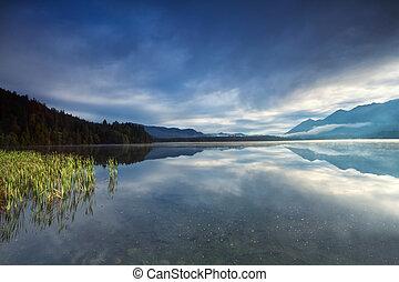 misty sunrise on alpine lake Barmsee