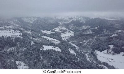 Misty valley of mountains in snow - Picturesque panoramic...