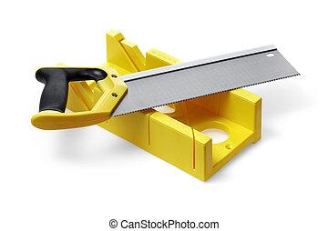 Miter box - A yellow miter box and a backsaw on white