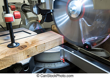 Miter saw - Closeup of mature sawing lumber with sliding ...