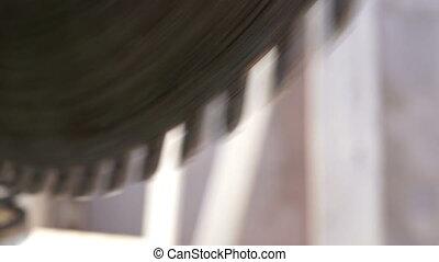 Miter Saw Radial Blade Teeth Macro - Close up macro shot of...