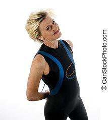 mittleres alter, weibliche , triathlete, in, schwimmender, nasse klage