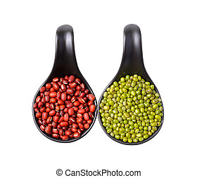 Mix beans in ceramic spoons on white background