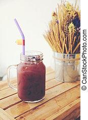 mix berry juice on wood background