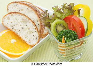 mix healthy salad cup and whole wheat bread in the white plate