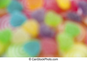 Mix jelly fruits on abstract background blur