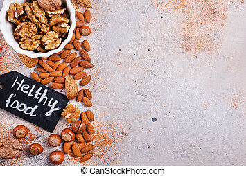 mix nuts - Mix nuts on beton background. Cut nuts