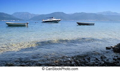 "mix of 2 shots boats on a quiet sea,  ""Bay of Kotor""  (""Boka Kotorska""), Montenegro"