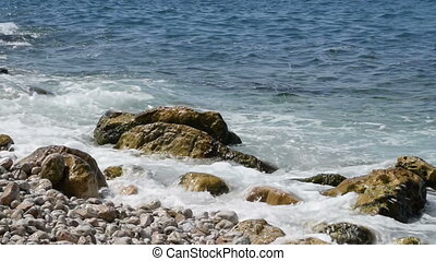 mix of 2 shots, the sea lapping at the shore