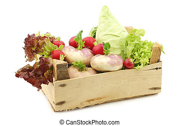 mix of cabbage, lettuce and turnips in a wooden crate