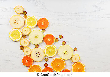 Mix of colored fruits on white wooden background - Composition of tropical healthy eating and food background