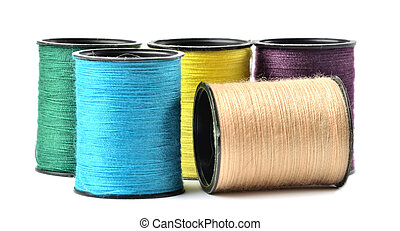 Mix of colored thread spool isolated on white background