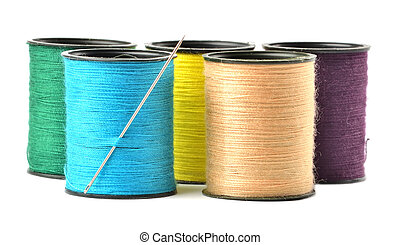 Mix of colored thread spool with needle isolated on white background