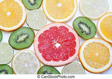 Mix of colorful citrus fruit on white background .