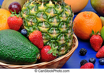 Mix of colorful fresh fruits in a basket