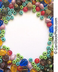 Mix of different beads vertical background with space for text. Flat lay hobby, handmade, fine arts concept.