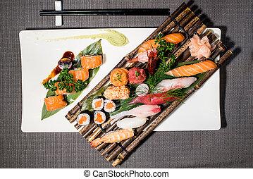 Mix of different japanese traditional food, urumaki, nighiri...