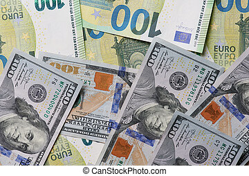 Mix of dollar and euro banknotes