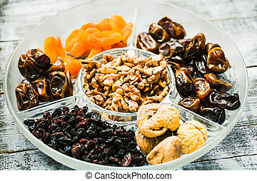 Mix of dried fruits and nuts, health food concep.