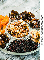 Mix of dried fruits and nuts, health food concept.
