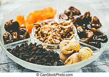 Mix of dried fruits and nuts, health plant-based concep. Toning