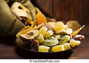 dried fruits - mix of dried fruits on wooden table
