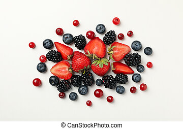 Mix of fresh berries on white background, top view