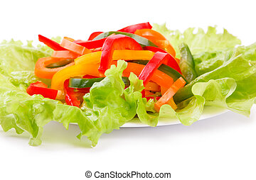 Mix of fresh vegetables from a colored paprika on leaves of ...