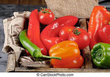 Mix of hot chili peppers in a rustic tray. Top view.