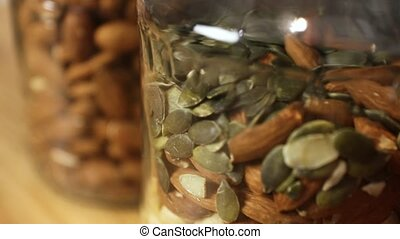 Mix of nuts and seeds - Nuts and seeds in jars in the...