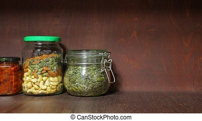 Mix of nuts and seeds - Nuts and seeds in jars put on the...