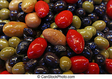 Mix of olives in oil close up