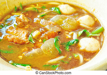 Mix of Pork meatballs and Pork stew in spicy soup - Mix of ...