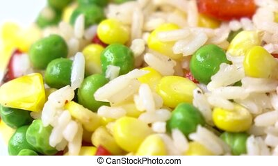 Mix of rice, corn, peas and red sweet pepper, 4K macro dolly shot