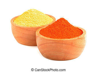 mix of spices in wooden bowl isolated on a white background