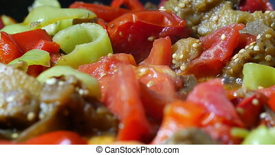 Mix of vegetables cooked in pan - Close-up shot of...