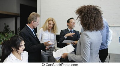 Mix Race Secretary Giving Business People Team Reports With...