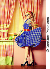Modern pin-up girl wearing old-fashioned polka-dot dress and modern hairstyle dreadlocks. Fashion shot. Mixture of styles.