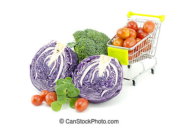mix vegetables, purple cabbage, cherry tomatoes on trolley, broccoli and mint isolated white background