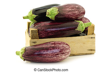 mixed aubergines in a wooden crate