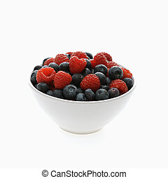 Mixed berries. - Bowl of mixed blueberries and raspberries...