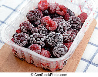 mixed berries in plastic box