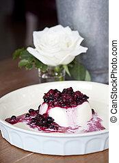 Mixed berries panacotta on white plate