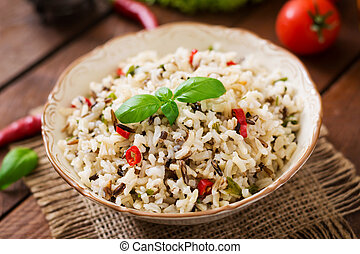 Mixed boiled rice with chilli and basil. Dietary menu.