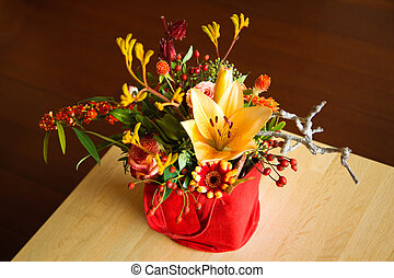 Mixed bouquet of yellow, red and orange flowers