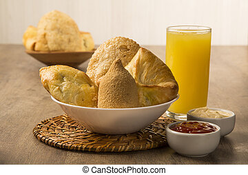 Mixed Brazilian deep fried chicken snack,, esfihas and pastry with juice and soda - popular at local parties.