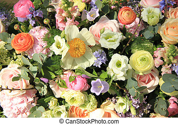 Mixed bridal flower decorations: peonies, ranunculus and roses in pastel colors