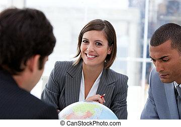 Mixed-business team talking around